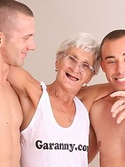 Two younger guys get their cocks serviced by a hot granny