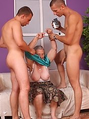 Granny lifts her skirt to get fucked by young studs
